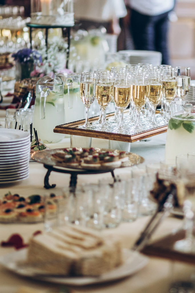 Champagne flutes and appetizers on a table