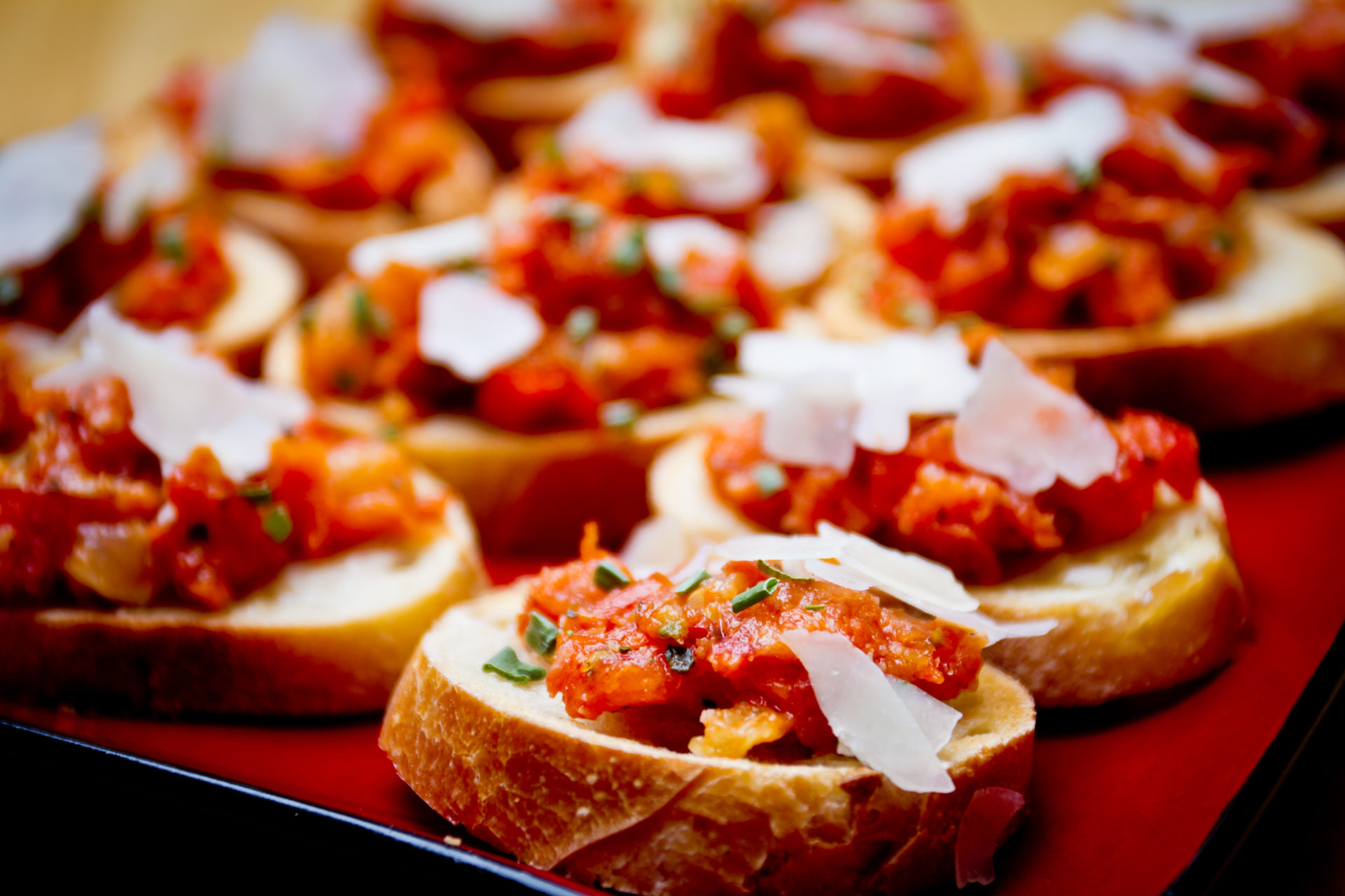 Bruschetta with minced tomato, garlic, olive oil and shaved parmesan cheese