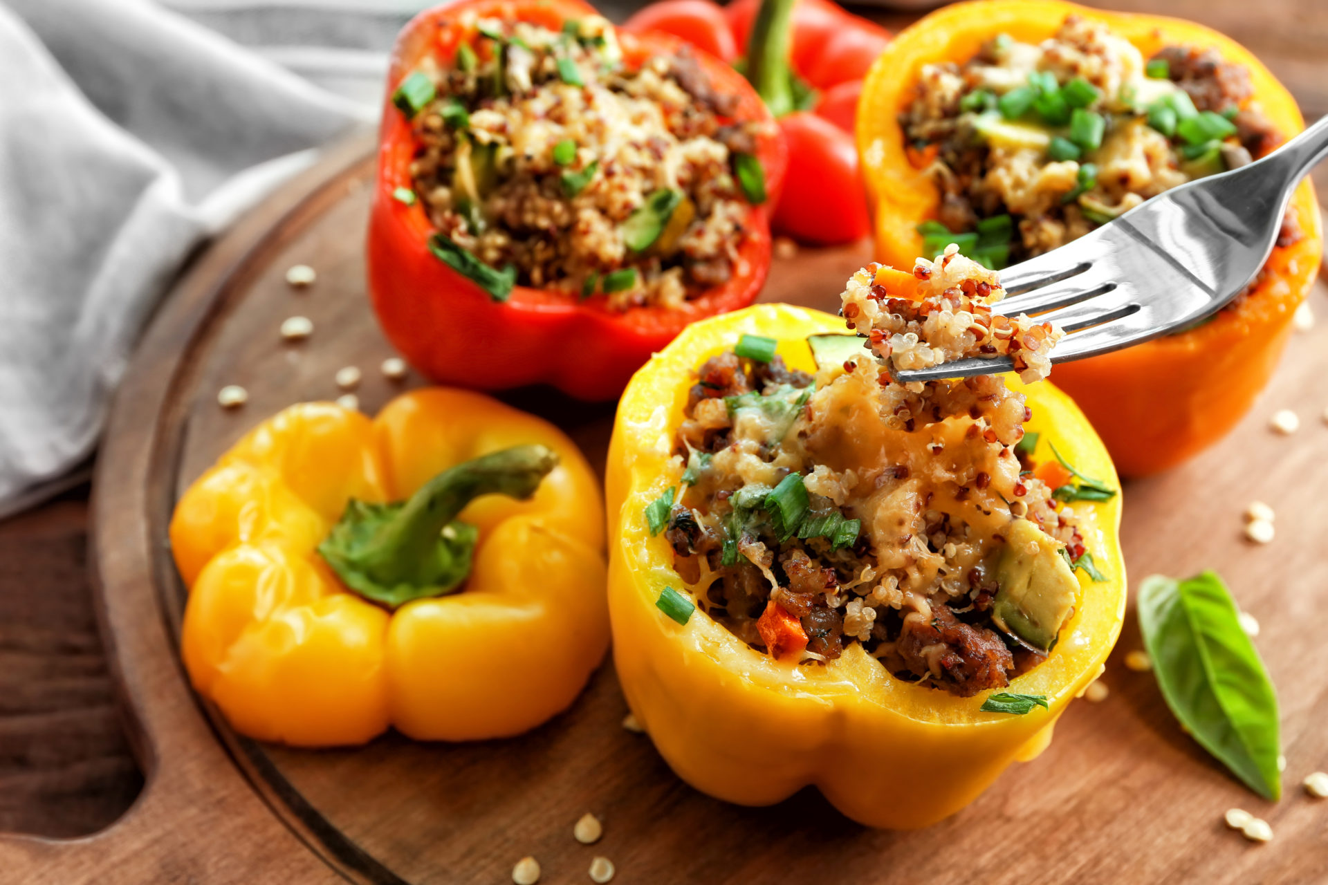 Stuffed bell peppers on wooden board